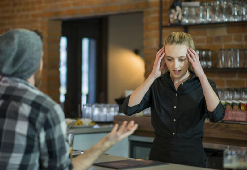 stressed employee with aggressive customer