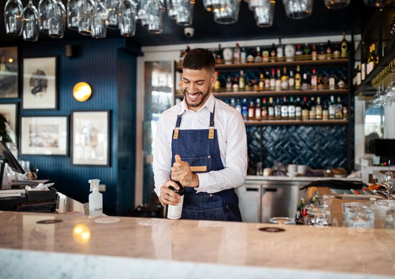 bar staff working in hospitality requiring security services